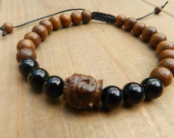 Adjustable bracelet, 18 beads and robles wood 6 onyx, 8mm beads, cotton thread, and Buddha.