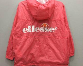 """Vintage Ellesse Windbreaker Jacket Half Zipper Spell Out Big Logo Pink Color Medium Size Chest 24.5"""""""