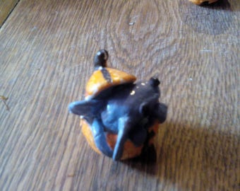 Mouse in a polymer clay pumpkin