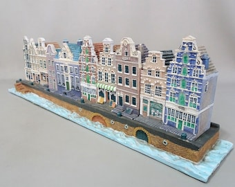 Old Dutch Amsterdam Canal houses and boat on a plateau tray 1996, Netherlands. Celebration of the 100th anniversary of Blokker