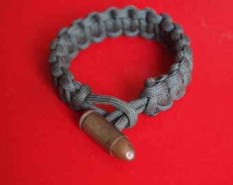 Military green paracord bracelet with casing