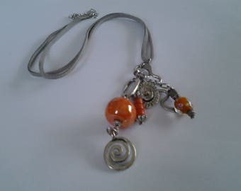 Orange mid long to multiple pendant necklace