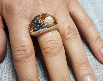 A designed 925 silver ring with natural pearl