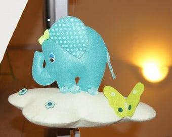 Mobile cloud and little elephants in felt