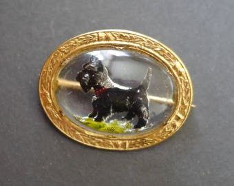 Vintage reverse carved glass brooch Scottish signed Mizpah Miracle, with little terrier