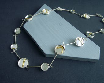 Healing cycle. Geometric Necklace shows broken and healed mirrors, connected with T links. Using Kintsugi in recycled silver