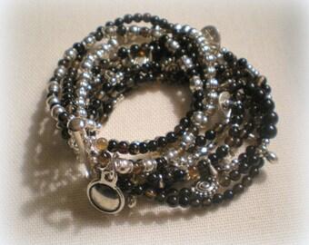 MULTI STRAND BRACELET ... black and silver