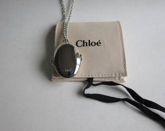 Chloe, long necklace solid perfume Locket. Signed with original box.