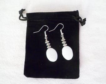 Fancy, silver and white stone earrings