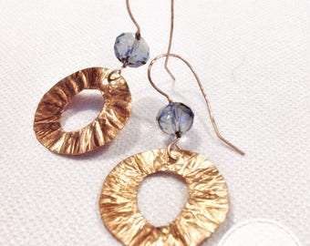 Whipped metal circles tied with elegant blue beads