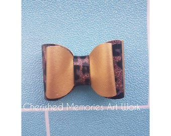 Gold and leopard print bow