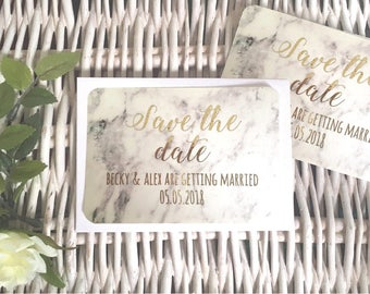 Save the date cards with real foil. Marble effect save the date cards with gold foil. Personalised save the date wedding cards with foil.