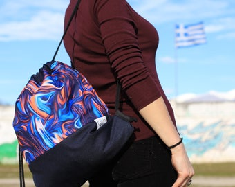 SUNSET KARYA waterproof drawstring backpack with lining and zipped pocket. Unique design.
