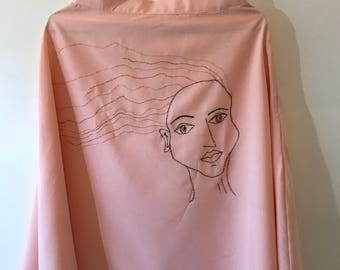 Pink skirt with embroidered face