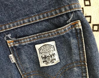 Beautifully worn levi's white tab jeans