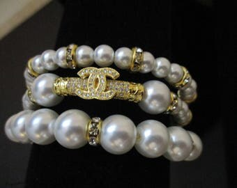 Designer inspired white pearl and gold toned rhinestone 3 strand cuff style adjustable bracelet