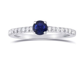 A classic round sapphire and diamond engagement ring,mounted in all white gold . The  Blue sapphire is from Sri Lanka in origin,SKU : 297515
