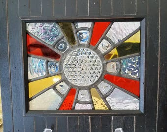 Vintage plate in stained glass with frame.