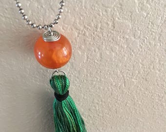 Orange and green tassel necklace
