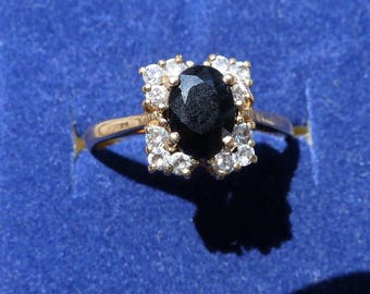 Sapphire and diamond cluster ring in 9ct gold setting