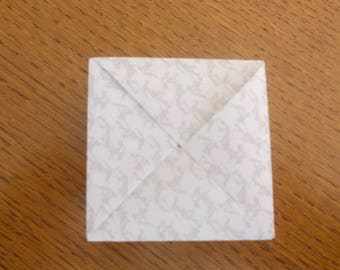 Paper 70 g folded Origami gift box.