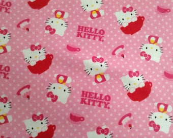38 inches of Flannel/Licensed/Hello Kitty on pink background cotton fabric