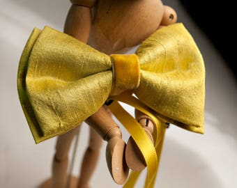 Bright yellow yellow bow tie for holidays