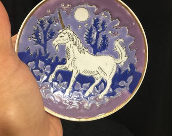 Collector's Case by Fingerhut. Small porcelain plate, hand painted unicorn trotting through forest at midnight hour, full moon.