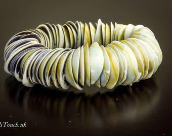 Stylish stretch natural sea shell bracelet.