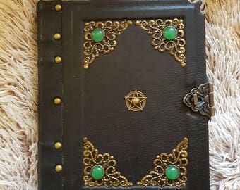 Ancient handmade leather grimoire.  Spell book