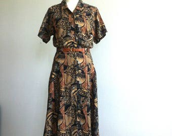 SOLD 1980 Africa inspired print long button-up viscose dress with pockets