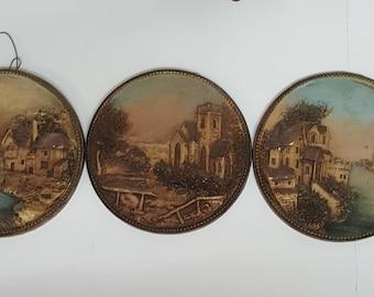 Set of Three Raised Relief Ceramic Plaques