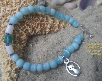 Cat's eye  beaded bracelet. Aqua white green blue glass beads. Original design. Cat lovers bracelet. Cat Charm