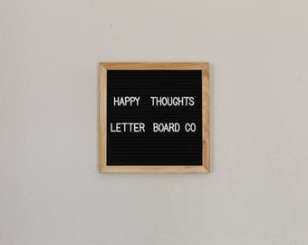 "Black felt letter board 10""x10"" white plastic letters,numbers,symbols"