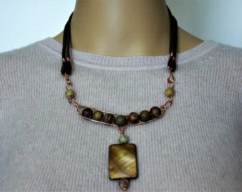 Multicolored beads with amber shell pendant