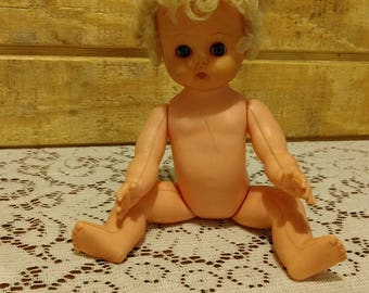 """Vintage 1950s / 1960s 10"""" Jolly Toys plastic jointed Doll blue sleep eyes, rubber head, rooted blonde hair"""