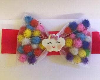 Adorable pompom headband with a charm cloud unicorn.