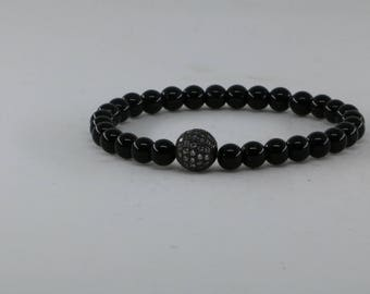 Black beads bracelet withA ball studded with zircons The beads make Onyx stones The bracelet is suitable for both men and womene .