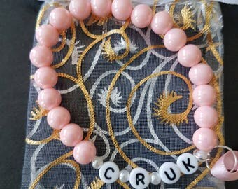 Hand made cancer research beaded bracelet, with free gift bag.