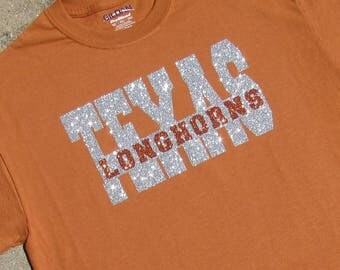 University of Texas Longhorns Glitzy Bling Short Sleeve Spirit T-Shirt with Silver and Orange High Sparkle Glitter  on a Texas Orange Shirt
