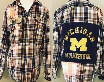 Upcycled distressed cozy flannel with a Michigan Wolverines patch size men's L/women's XL