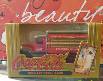 COCA-COLA die-cast metal truck bank. 1993 new sealed in box.