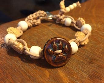 Leather and bone bracelet with ceramic Paw and lobster clasp