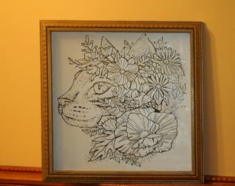 cat with flowers on a mirror  picture  frame