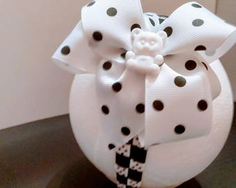 Hand wrapped headband with removable bow