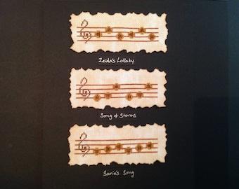 Framed Zelda cross stitch, Ocarina Songs.