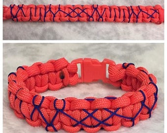 Orange Deluxe Paracord Clad bracelet with royal blue microcord detail