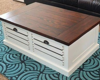 County/farmhouse coffee table with crates for storage.
