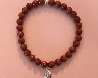 Goldstone with sterling silver accents