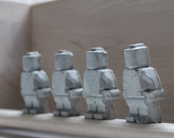 Concrete Lego men